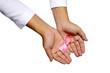 Human Hand Holding Pink Ribbon