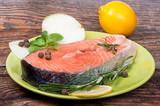 Fresh raw salmon red fish steak with herbs and vegetables