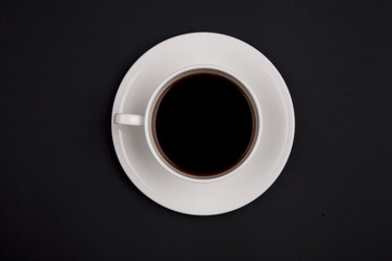 White cup of coffee top view