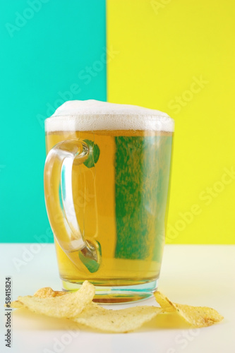 Bocal of beer and potato chips