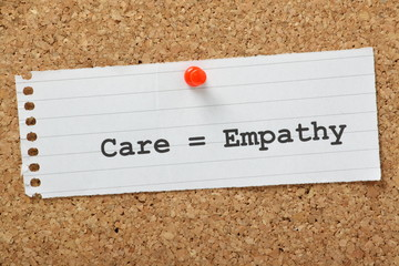 Care equals Empathy on a cork notice board