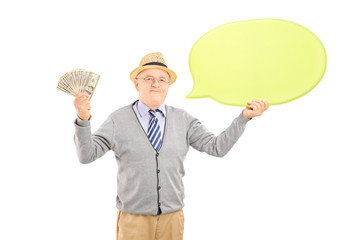 Senior happy gentleman holding a speech bubble and dollars