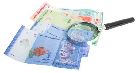 Malaysia bank notes money with magnifying glass