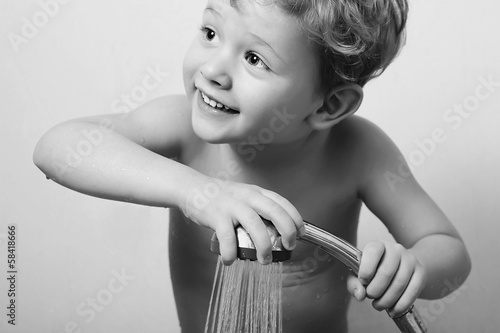 smiling little boy in the shower.Bath.child.monochrome