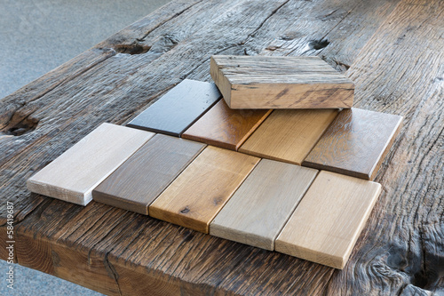 Samples of different kinds of wood in a furniture shop - 58419687