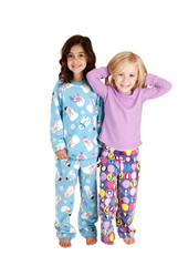 Young girls wearing winter christmas pajamas smiling
