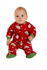 toddler boy sitting in red snowman pajamas