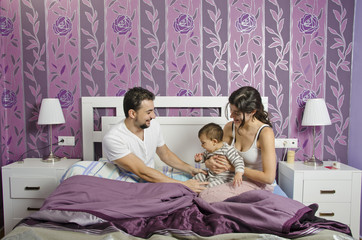 Family at bedroom.