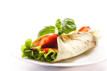 pita bread with lettuce, salami and tomatoes