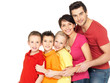 Happy family with children standing together in line