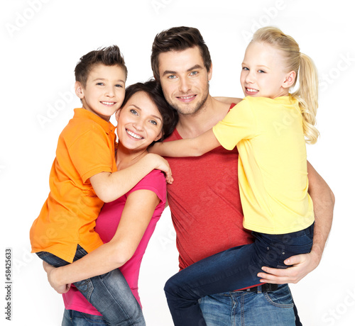 Happy family with two schoolchild children