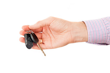The man hand holds cars key