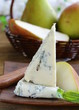 Blue cheese and pears on a wooden plate