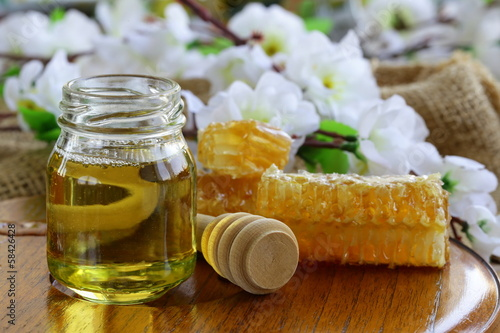 natural organic honey in the comb and  glass jar
