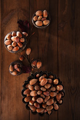 wild haselnut in iron bowls on wooden table