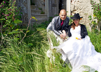Bride and groom outside ruins