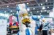 Leinwanddruck Bild - Robot arm in a factory