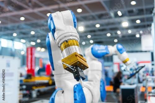 Leinwanddruck Bild Robot arm in a factory