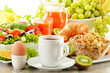 Breakfast with coffee, juice, croissant, salad, muesli and egg