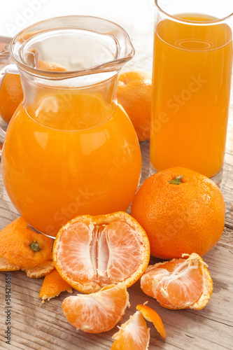 fresh mandarin fruits with juice on a wooden board