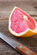 slice of grapefruit and knife