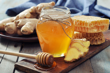 Honey in jar with fresh ginger