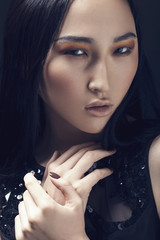 Makeup Face. Asian Woman with Perfect Make up. Beautiful Profess