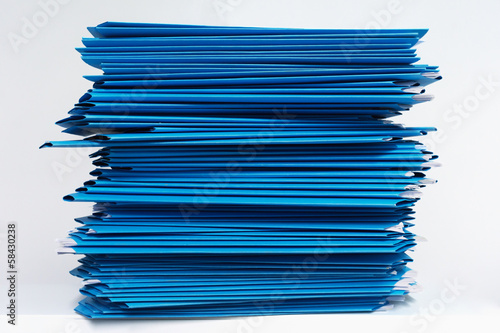 stacks of blue folders over white background