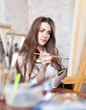girl paints in workshop