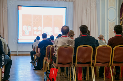 people sitting at the business conference