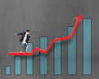 Businessnan surfing on growth red arrow with histogram drawing