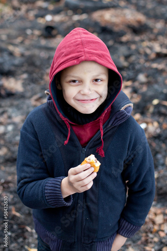 homeless boy eats cookies