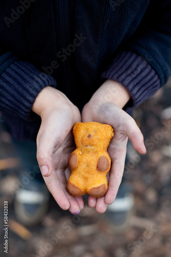 homeless boy holds cookies in hand