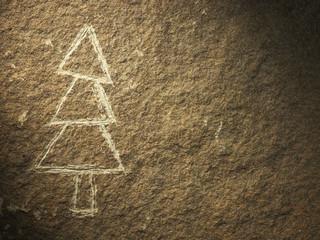 rock painting of christmas tree
