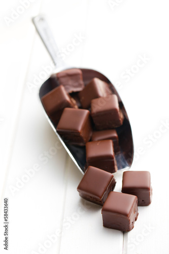 chocolate pralines on metal scoop