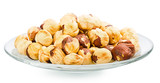 A pile of shell-less hazelnuts, isolated on white background
