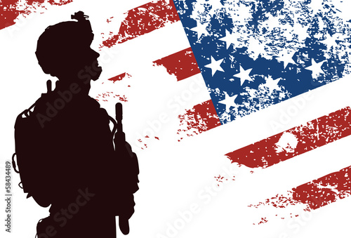 US soldier with the American Flag on the background - 58434489
