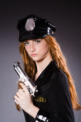 Redhead police office with gun