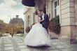 Young wedding couple dancing outdoor