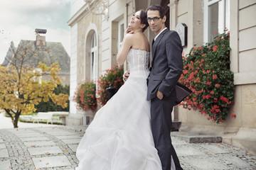 Young bride in tender hug