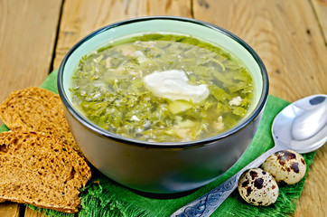 Soup green of herbs on the board