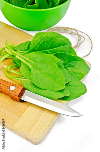 Spinach on the board with a bowl