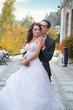 Aluring bride with her handsome bridegroom