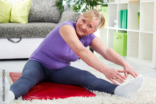 Senior woman exercising in home gym