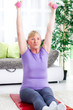 senior woman exercise with weights  at home