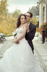 Calm and pleased wedding couple