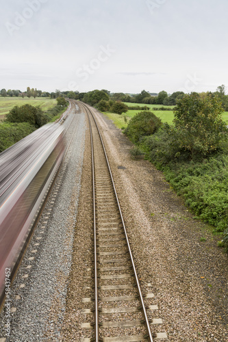 Railway or railroad with blurred train