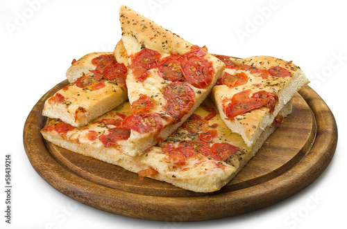 Focaccia with tomatoes and oregano close up