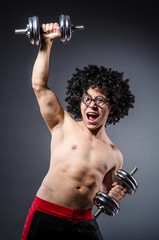 Funny man exercising with dumbbells