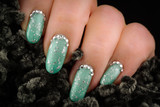 Green nails with glitter and rhinestones poster